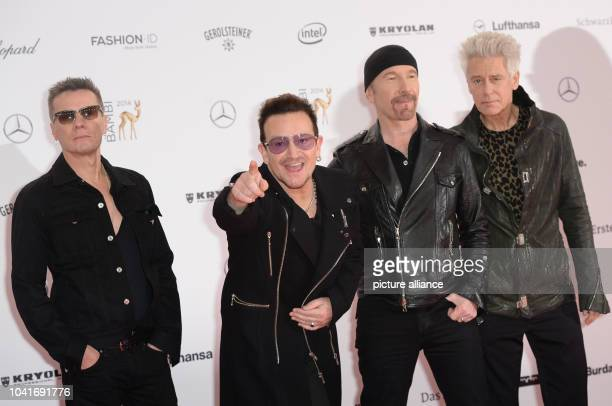 Irish band U2 with lead singer Bono  arrive on the red carpet before the Bambi Awards at the Stage Theater on Potsdamer Platz in Berlin Germany 13...