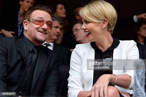 Irish band U2's lead singer Bono and South African actress Charlize Theron attend the memorial service of South African former president Nelson...