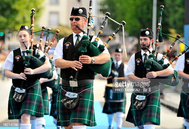 Irish band Youghal Pipe performs traditional music on August 7 2011 in Lorient during the celtics nations Great Parade of the 'festival interceltique...