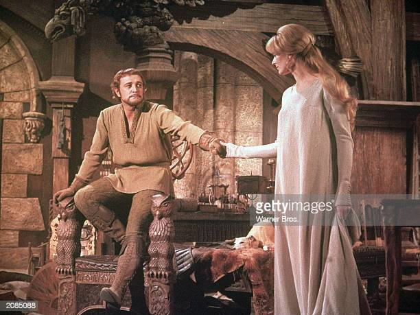 Irish born actor Richard Harris as King Arthur holds the hand of British actor Vanessa Redgrave as Guenevere in a still from the film 'Camelot'...
