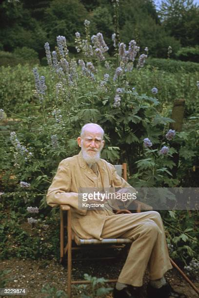 Irish born playwright and winner of the 1925 Nobel Prize for Literature George Bernard Shaw sitting in the garden of his country home in Ayot St...