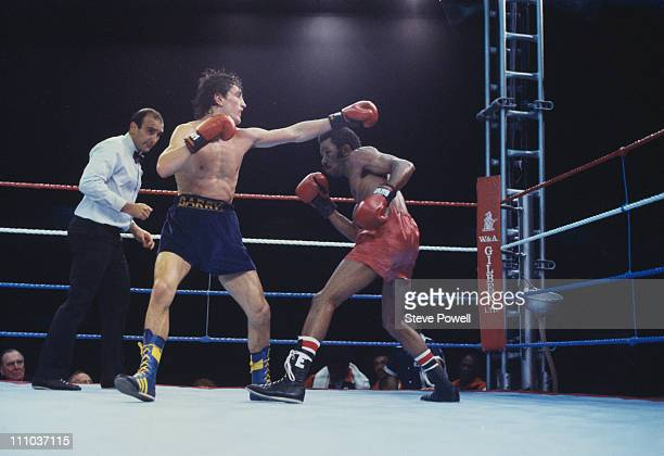 Irish boxer Barry McGuigan in the ring with Eusebio Pedroza of Panama during their WBA world featherweight title fight at Loftus Road football...