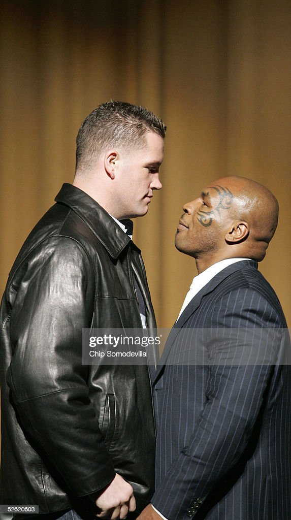 Irish boxer Kevin McBride (L) and two-time heavyweight boxing champion Mike Tyson pose during a press conference announcing their upcoming fight April 12, 2005 at the Lincoln Theater in Washington. The fight will be June 11 at MCI Center in Washington.