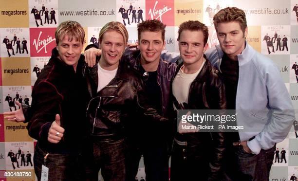 Irish boy band Westlife from left to right Kian Egan Nicky Byrne Mark Feehily Shane Filan and Bryan McFadden at the Virgin megastore in Manchester...