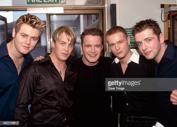 Irish boy band Westlife pose backstage at a TV show, London, 2001. Left to right: Brian McFadden, Kian Egan, Shane Filan, Nicky Byrne and Mark...