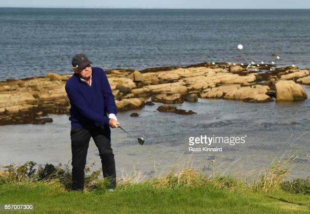 Irish Businessman Dermot Desmond plays onto the 12th green during practice prior to the 2017 Alfred Dunhill Links Championship at Kingsbarns on...