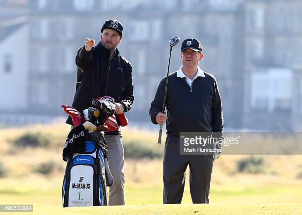 Irish businessman JP McManus with his caddie on the second hole during the first practise round of the 2015 Alfred Dunhill Links Championship at The...