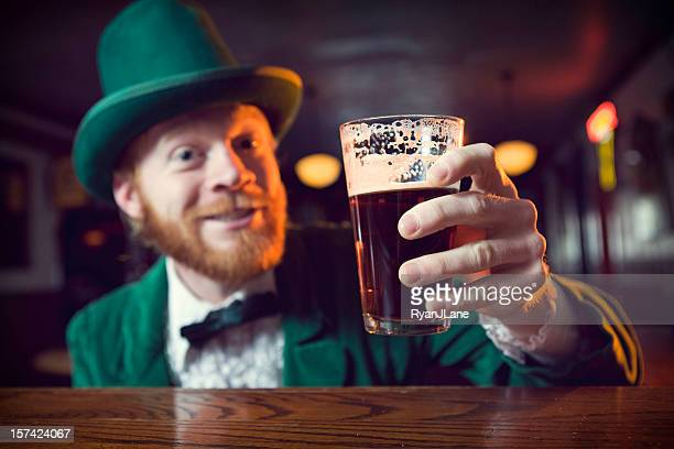 irish character / leprechaun making a toast with beer - st patricks day stock pictures, royalty-free photos & images