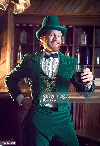 irish character / leprechaun making a toast with beer - tail coat stock pictures, royalty-free photos & images