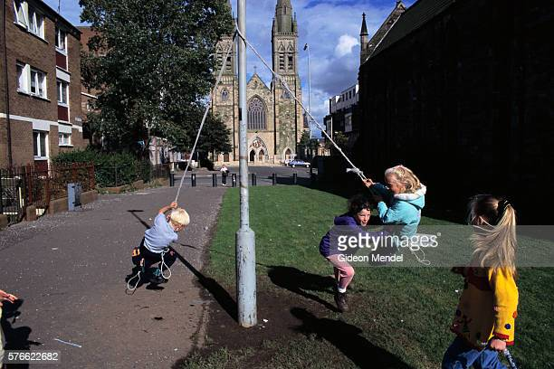irish children swinging on a rope - falls road stock pictures, royalty-free photos & images