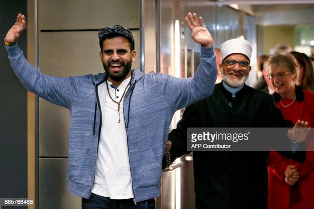 Irish citizen Ibrahim Halawa gestures to wellwishers family and friend next to his father Hussein Halawa as he arrives at Dublin Airport on October...