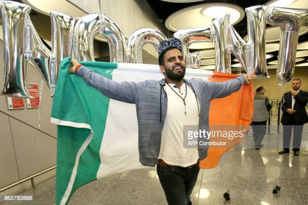 Irish citizen Ibrahim Halawa poses with an Irish flag as he arrives at Dublin Airport on October 24 2017 following his release from detention in...