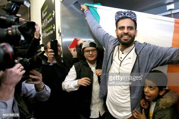 Irish citizen Ibrahim Halawa poses with family members as he arrives at Dublin Airport on October 24 2017 following his release from detention in...