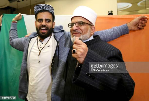 Irish citizen Ibrahim Halawa poses with his father Hussein Halawa as he arrives at Dublin Airport on October 24 2017 following his release from...