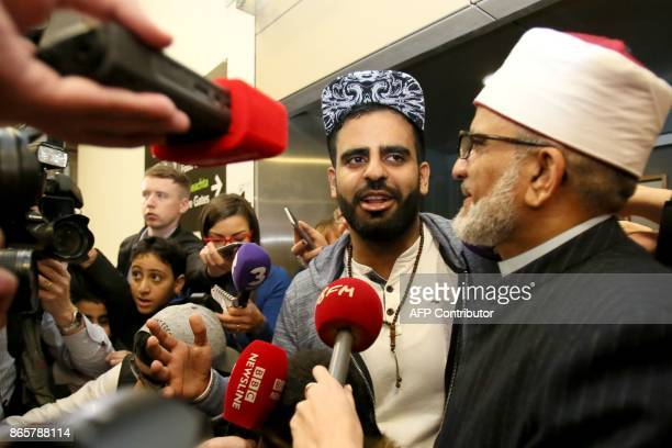 Irish citizen Ibrahim Halawa speaks to the press as he stands by his father Hussein Halawa after arriving at Dublin Airport on October 24 2017...