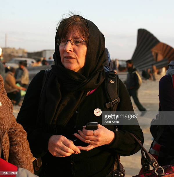 Irish citizen Treasa Ni Cheannabhain 56 waits with her daughter daughter Naishrin elSafty to cross back into Egypt at the border crossing on February...