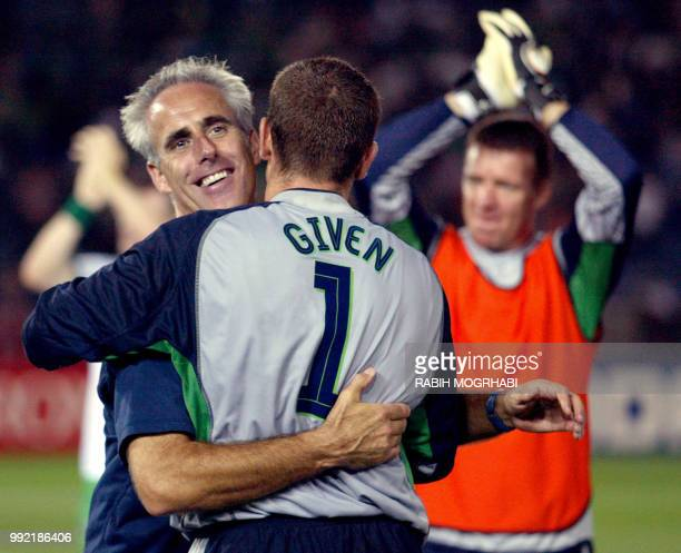 Irish coach Mick McCarthy congratulates his goalkeeper Shay Given after winning the Group E first round match against Saudi Arabia counting for the...