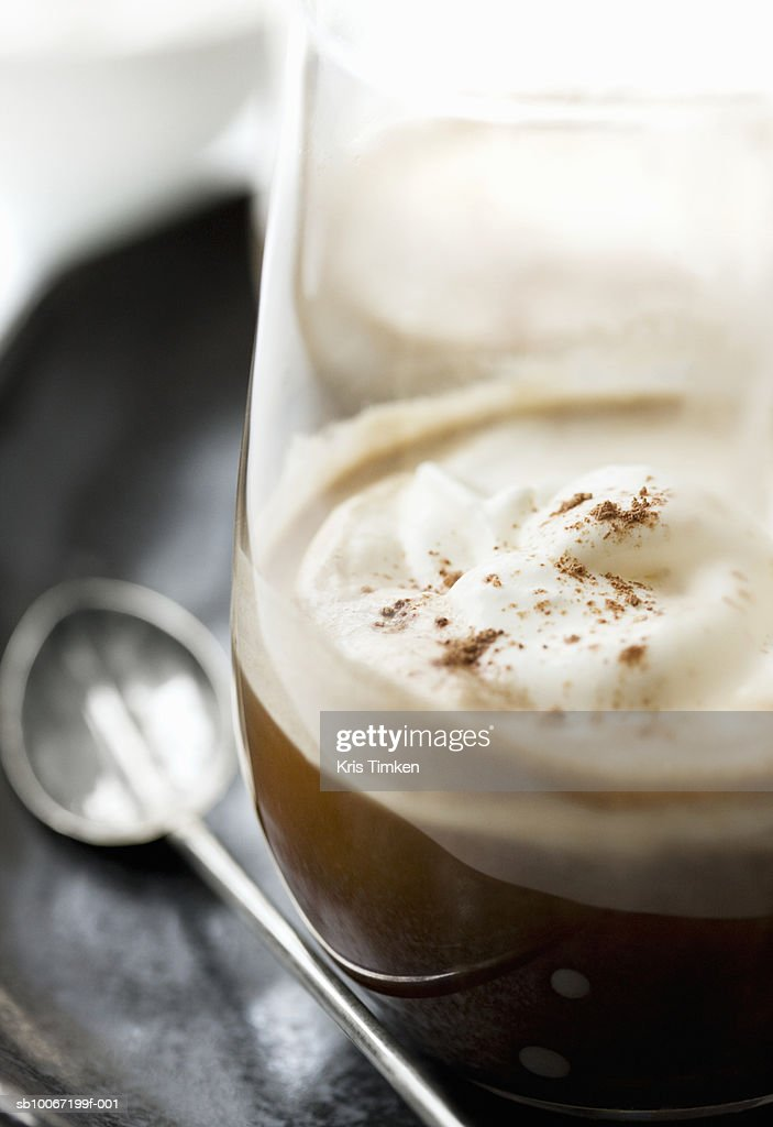 Irish coffee with whipped cream and nutmeg, close-up : Stock Photo