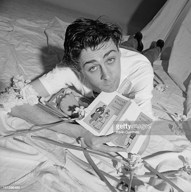 Irish comedian Sean Hughes 24th April 1992 He is holding a book of epigrams by Oscar Wilde