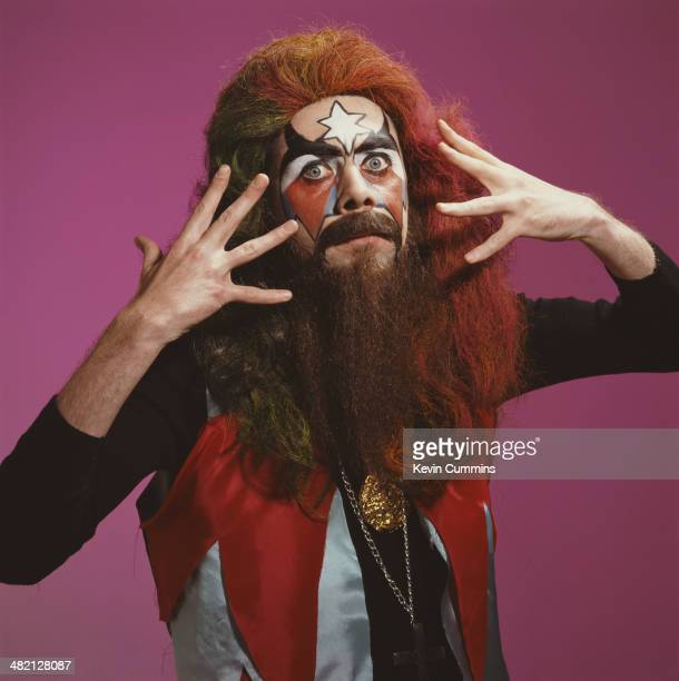Irish comedian Sean Hughes wearing a wig false beard and face paint in imitation of musician Roy Wood of British pop group Wizzard circa 1995
