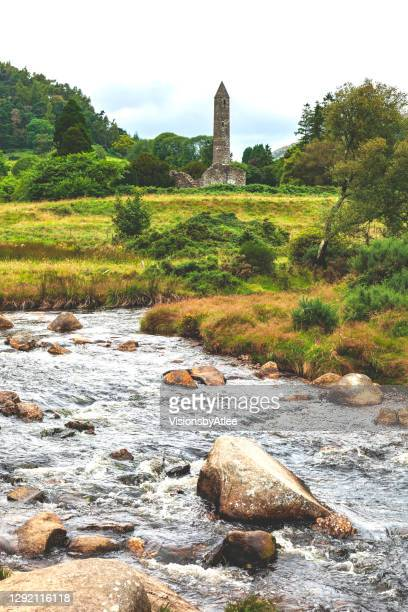irish countryside near dublin with a rocky stream and an abandoned stone  tower in the background - leinster province stock pictures, royalty-free photos & images