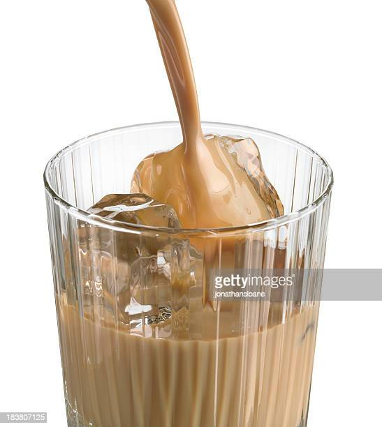irish cream liqueur pouring into crystal glass - liqueur stock pictures, royalty-free photos & images