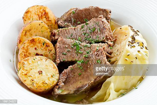 irish cuisine, corned beef, cabbage an roasted potatoes - boiled stock pictures, royalty-free photos & images