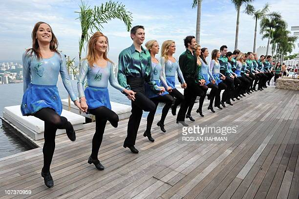 Irish dance troupe, the Riverdance, perform on top of Marina bay Sands' Skypark, 200 metres above ground level in Singapore on December 7, 2010....