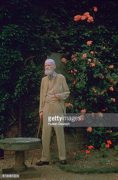 Irish dramatist George Bernard Shaw in a rose garden His most famous plays include Pygmalion Saint Joan The Devil's Disciple and Caesar and Cleopatra...