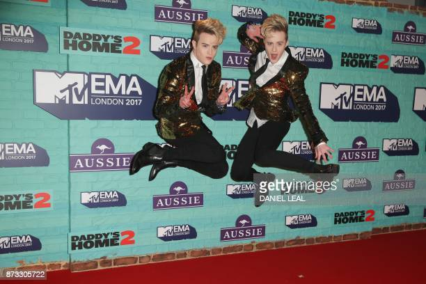 Irish duo John and Edward Grimes AKA Jedward pose on the red carpet arriving to attend the 2017 MTV Europe Music Awards at Wembley Arena in London on...