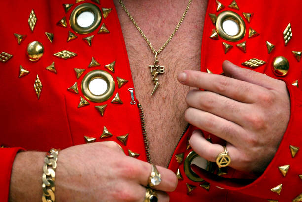 The king still reigns during memphis elvis week irish elvis presley tribute artist the emerald elvis mark leen adjusts his jumpsuit and mozeypictures Image collections