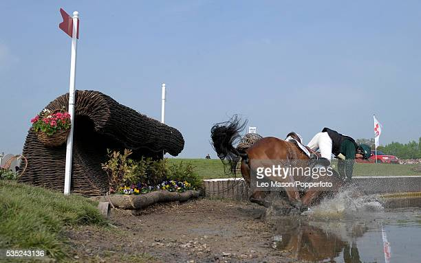 Irish equestrian Sarah Wardell riding Killeenduff Boy enters the lake complex to fall during competition in the Cross Country Test section at the...