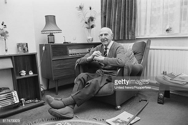 Irish ex footballer and ex captain of Sheffield United Billy Gillespie pictured sitting in an armchair at home on 4th December 1980
