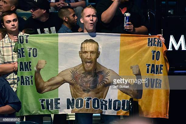 Irish fans celebrate after Conor McGregor of Ireland defeated Dustin Poirier in their featherweight bout during the UFC 178 event on September 27...
