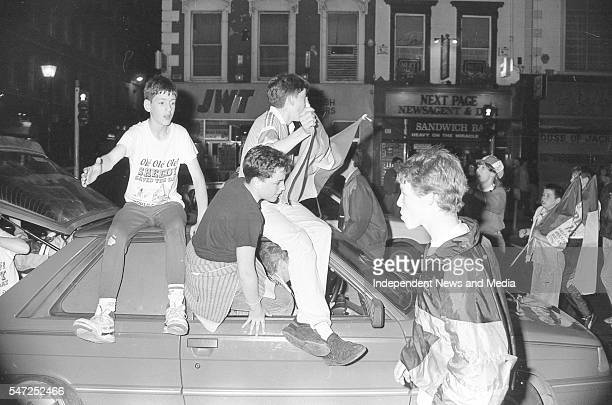 Irish fans celebrate Ireland's draw with Holland in Dublin's O'Connell St 21/6/90 PIC DOMINIC LEDWIDGE O'REILLY . .