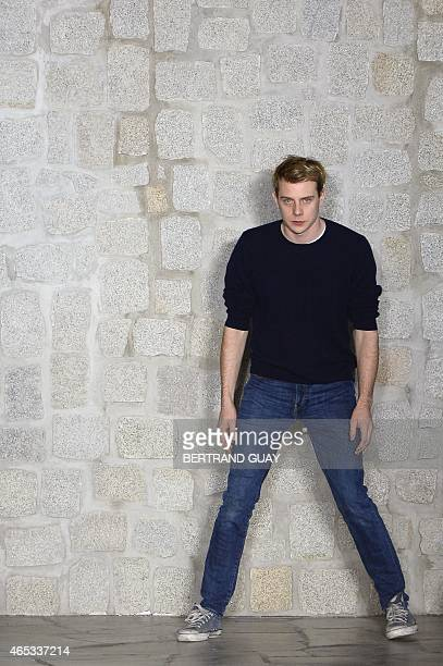 Irish fashion designer JW Anderson acknowledges the audience at the end of Loewe 20152016 fall/winter readytowear collection fashion show on March 6...
