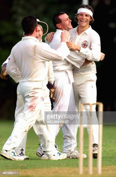Irish fast bowler Ryan Eagleson is congratulated by his teammates as he takes another South African wicket as Northern Ireland nearly upset South...