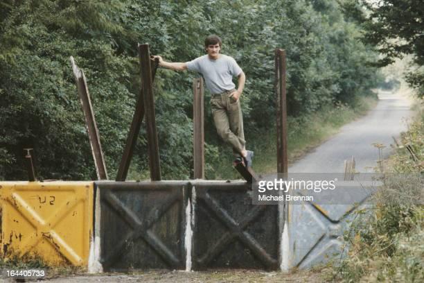 Irish featherweight boxer Barry McGuigan in his hometown of Clones Ireland 1984 He is posing astride the border between Ireland and Northern Ireland