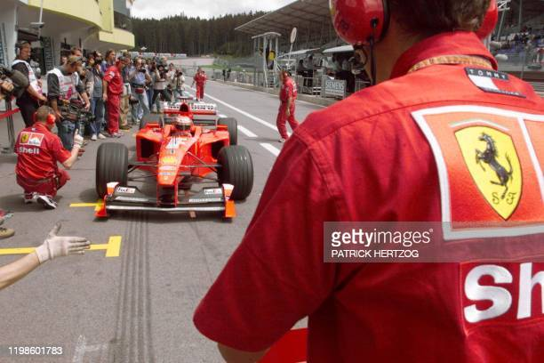 Irish Ferrari driver Eddie irvine gets inside the pits of the racetrack during the second free practice session in Spielberg 23 July two days before...