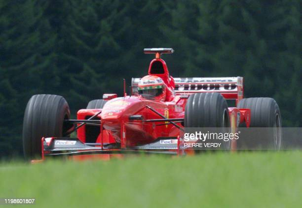 Irish Ferrari driver Eddie Irvine steers his car on the racetrack during the first free practice session in Spielberg 23 July two days before the...