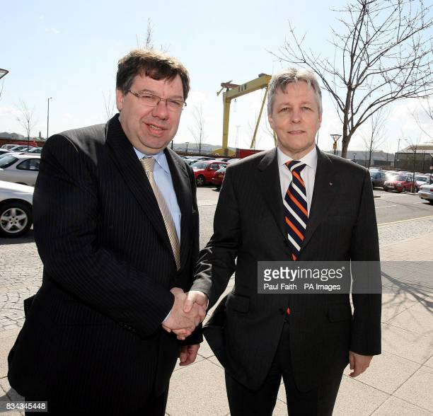 Irish Finance Minister, Brian Cowen , with new leader of the DUP, Peter Robinson, at the docks area of Belfast.