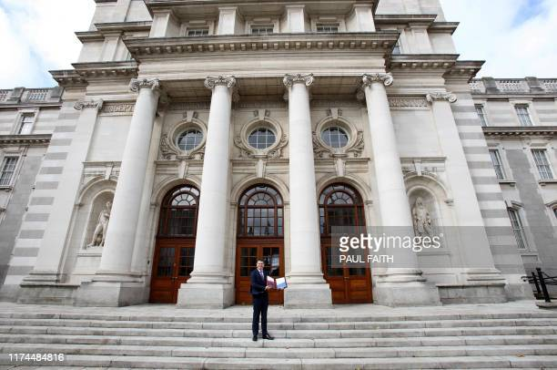 Irish Finance Minister Paschal Donohoe gestures during a photo call prior to presenting his Budget 2020 to parliament at Government Buildings in...