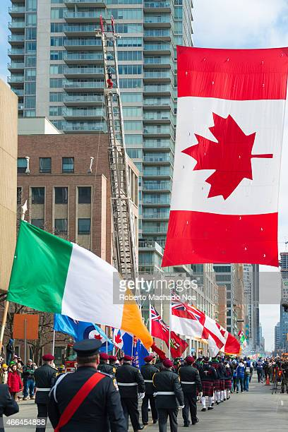 STREET TORONTO ONTARIO CANADA Irish flag along with Canadian flag during the St Patrick's Day Parade 28th edition which is the fourth largest...