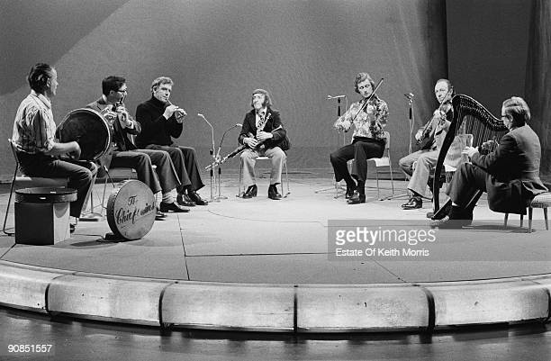 Irish folk group The Chieftains performing on a TV show 1976 Left to right Peadar Mercier Michael Tubridy Sean Potts Paddy Moloney Sean Keane Martin...