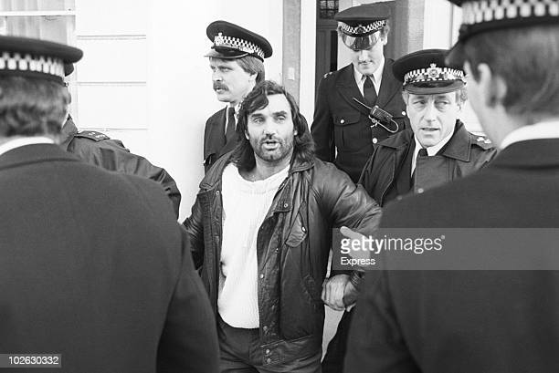 Irish footballer George Best being taken away by police after being arrested on drinkdriving charges on November 04 1984