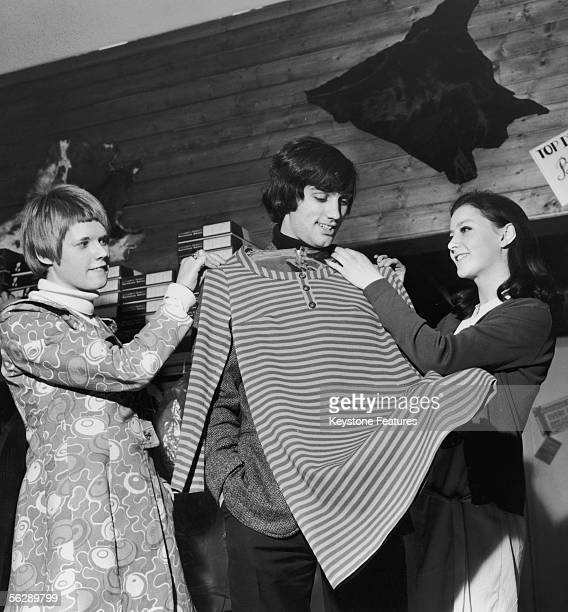 Irish footballer George Best of Manchester United tries on a shirt at the 'Best Boutique' a clothes shop owned by the soccer star in Sale Manchester...