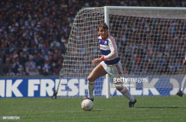 Irish footballer Michael Robinson on the ball for Queen's Park Rangers in the Football League Cup Final against Oxford United at Wembley Stadium...