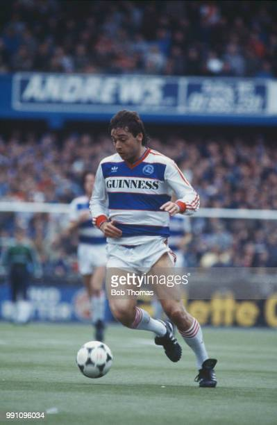 Irish footballer Michael Robinson on the ball for Queen's Park Rangers in a Football League First Division match against Watford FC at Loftus Road...