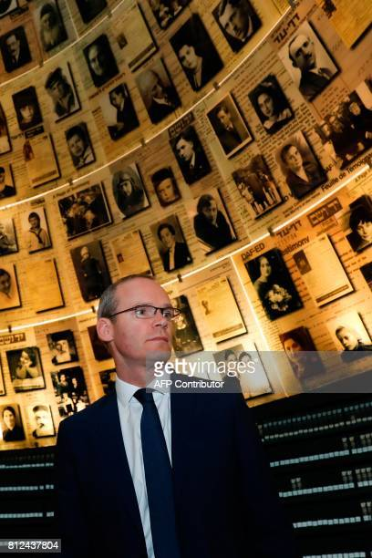 Irish Foreign Minister Simon Coveney looks at pictures of Jewish Holocaust victims on July 11 at the Hall of Names during his visit to the Yad Vashem...