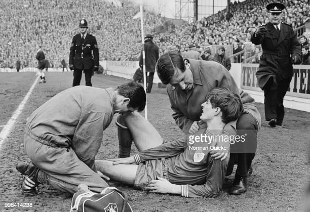 Irish former soccer player and manager of Leicester City FC Frank O'Farrell comforting soccer player Allan Clarke during the FA Cup semifinal against...